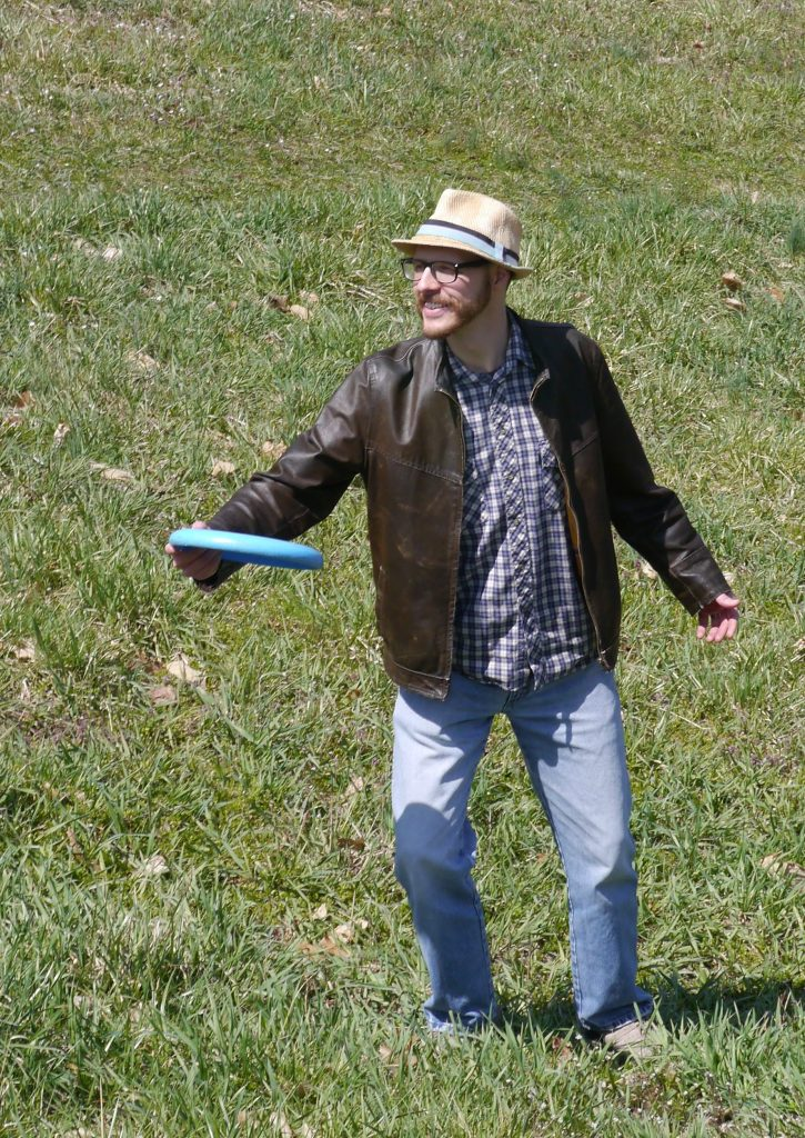 photo of Joshua Bowers Eno with a Frisbee